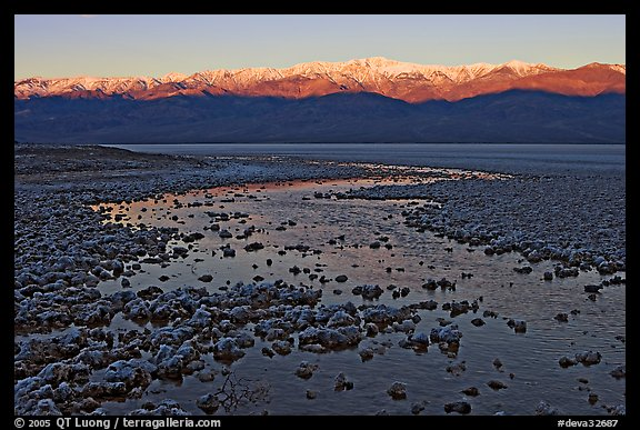 Salt pool and sunrise over the Panamints. Death Valley National Park (color)