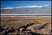 Valley with seasonal lake in the distance and Panamint Range, morning. Death Valley National Park, California, USA.