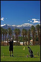 Golfer in Furnace Creek Golf course. Death Valley National Park, California, USA. (color)