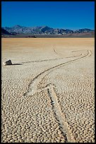 Zig-zagging track and sailing stone, the Racetrack playa. Death Valley National Park, California, USA. (color)