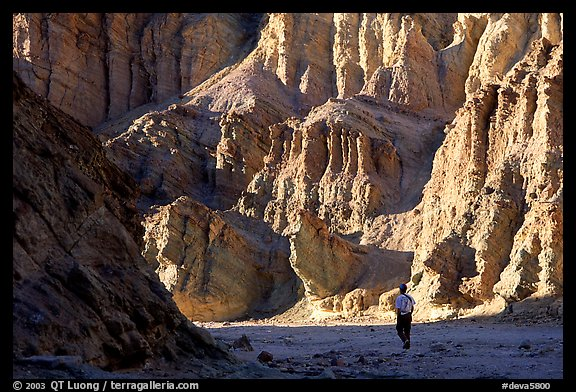 Hikers surrounded by tall walls in Golden Canyon. Death Valley National Park (color)