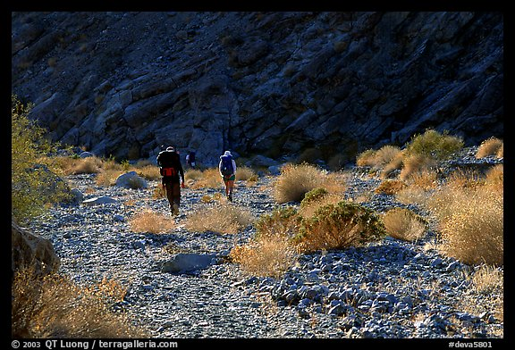 Hikers in a side canyon. Death Valley National Park (color)