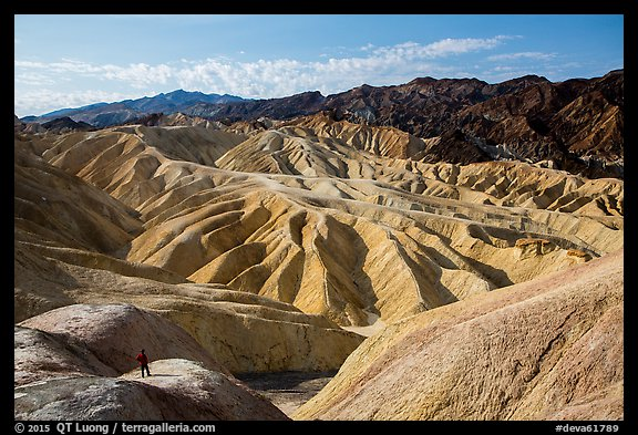 Visitor looking, Zabriskie Point. Death Valley National Park (color)