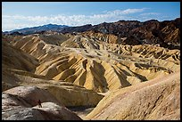 Visitor looking, Zabriskie Point. Death Valley National Park ( color)