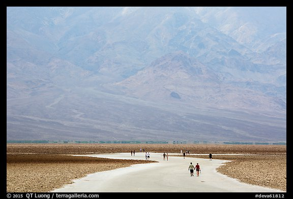 Tourists walking onto Salt Pan at Badwater. Death Valley National Park (color)