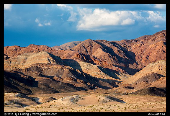 Distant Ibex Dunes at the base of multicolored mountains. Death Valley National Park (color)