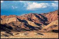 Distant Ibex Dunes at the base of multicolored mountains. Death Valley National Park ( color)