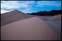 Ibex Sand Dunes and mountains at dusk. Death Valley National Park ( color)
