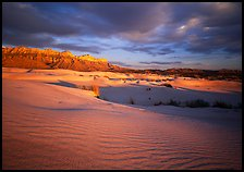 Red light of sunset on white sand dunes and Guadalupe range. Guadalupe Mountains National Park, Texas, USA. (color)