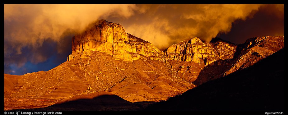 Cliffs and clouds illuminated by low sun. Guadalupe Mountains National Park (color)