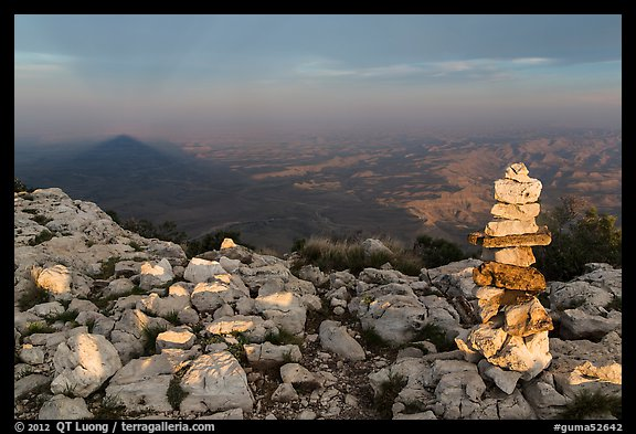 Cairn and shadow of mountain, Guadalupe Peak. Guadalupe Mountains National Park (color)