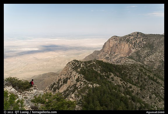 Hiker surveying view over mountains and plains. Guadalupe Mountains National Park (color)