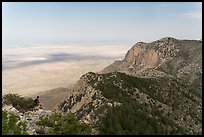 Hiker surveying view over mountains and plains. Guadalupe Mountains National Park ( color)