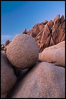 Spherical granite boulder and angular rocks, twilight. Joshua Tree National Park ( color)