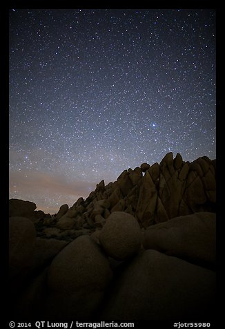 Marble rocks under clear starry sky. Joshua Tree National Park (color)