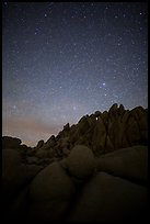 Marble rocks under clear starry sky. Joshua Tree National Park ( color)