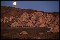 Moon rising about mountains. Joshua Tree National Park ( color)