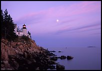 Bass Harbor lighthouse on rocky coast, sunset. Acadia National Park, Maine, USA.