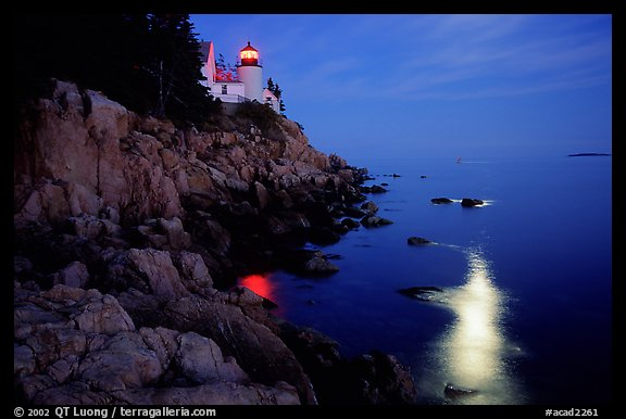 Bass Harbor lighthouse by night with moon reflection in ocean. Acadia National Park (color)