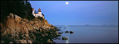 Dusk seascape with lightouse, moon, and reflection. Acadia National Park (Panoramic color)