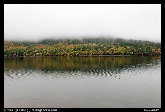 Hill reflected in Jordan Pond with top covered by fog. Acadia National Park (color)