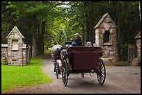 Carriage passing through carriage road gate. Acadia National Park, Maine, USA. (color)