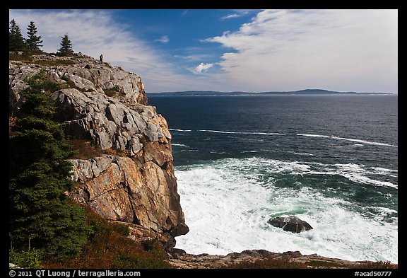Tall granite sea cliff with person standing on top. Acadia National Park (color)