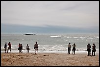 People standing on Sand Beach. Acadia National Park, Maine, USA.