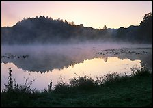 Mist raising from Kendall Lake at sunrise. Cuyahoga Valley National Park, Ohio, USA.