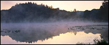 Fog rising of lake at dawn. Cuyahoga Valley National Park (Panoramic color)