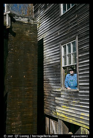 Miller standing at window, Mingus Mill, North Carolina. Great Smoky Mountains National Park (color)