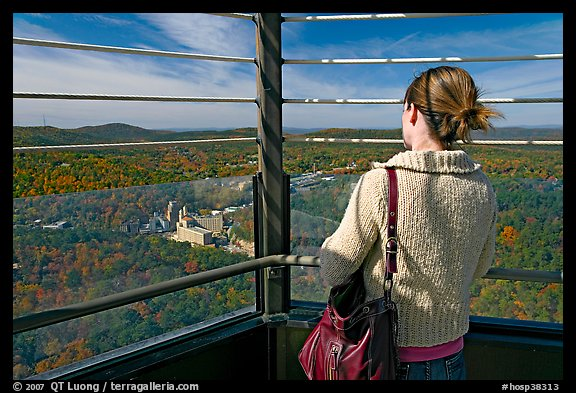 Tourist looking at the view from Hot Springs Mountain Tower in the fall. Hot Springs National Park (color)
