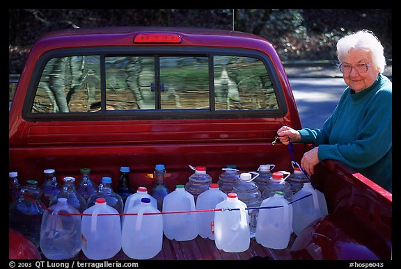 Resident stocks up on natural spring water. Hot Springs National Park (color)