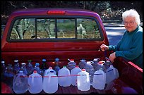 Resident stocks up on natural spring water. Hot Springs National Park, Arkansas, USA. (color)