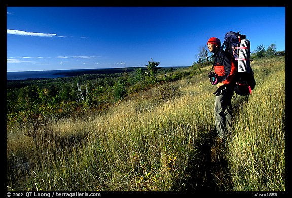 Backpacker pausing on Greenstone ridge trail. Isle Royale National Park (color)