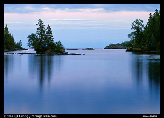 Tree-covered islet and smooth waters, Chippewa Harbor. Isle Royale National Park (color)