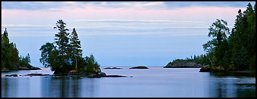 Tree-covered islet at dawn. Isle Royale National Park (Panoramic color)
