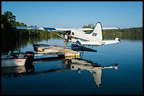 Pilot opening door at floatplane dock. Isle Royale National Park ( color)