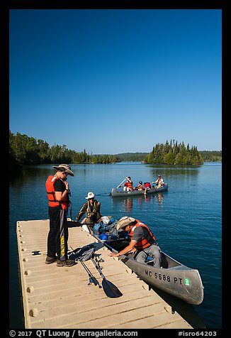 Canoists disembarking, Tobin Harbor. Isle Royale National Park (color)