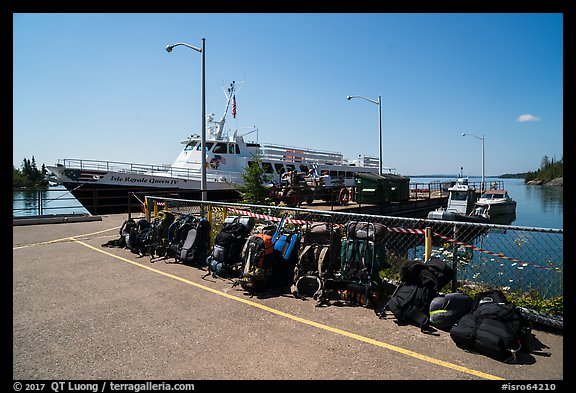 Backpacks lined up on dock, Rock Harbor. Isle Royale National Park (color)