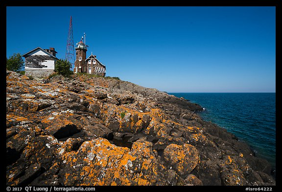 Lichen-covered rocks and Lighthouse, Passage Island. Isle Royale National Park (color)