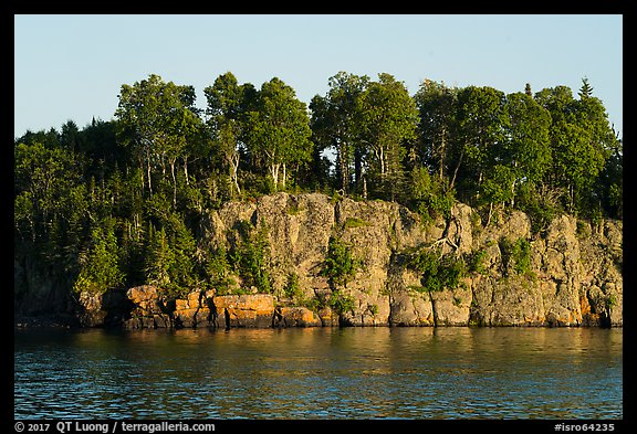 Sea cliffs and trees, late afternoon. Isle Royale National Park (color)