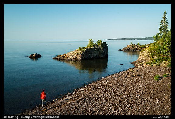 Visitor looking, Mott Island. Isle Royale National Park (color)
