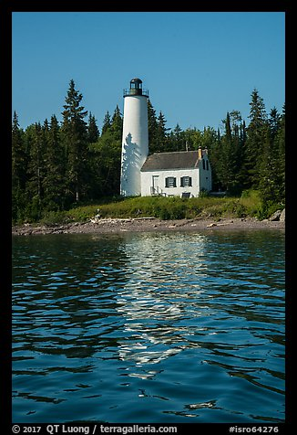Rock Harbor Lighthouse with tree shadaow and reflection. Isle Royale National Park (color)