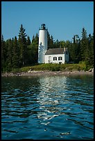 Rock Harbor Lighthouse with tree shadaow and reflection. Isle Royale National Park ( color)