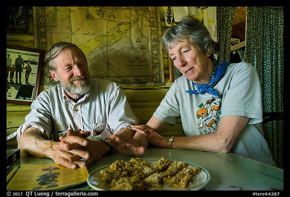 Rolf Peterson and Carolyn Peterson with plate of rhubarb pie in their home. Isle Royale National Park (color)