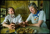 Rolf Peterson and Carolyn Peterson with plate of rhubarb pie in their home. Isle Royale National Park ( color)