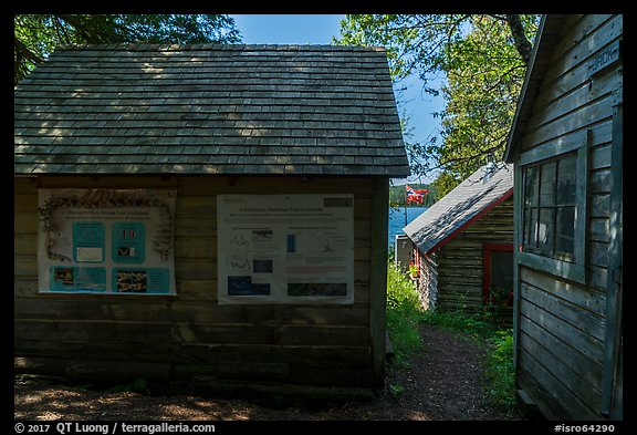 Bangsund Cabin with technical posters and norvegian flag. Isle Royale National Park (color)