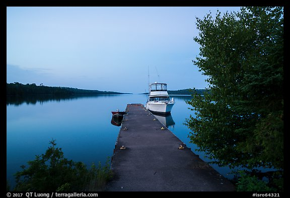 Moskey Basin dock with motorboat and ycaht, dusk. Isle Royale National Park (color)