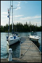 Sailboat and motorboat moored at Rock Harbor. Isle Royale National Park ( color)